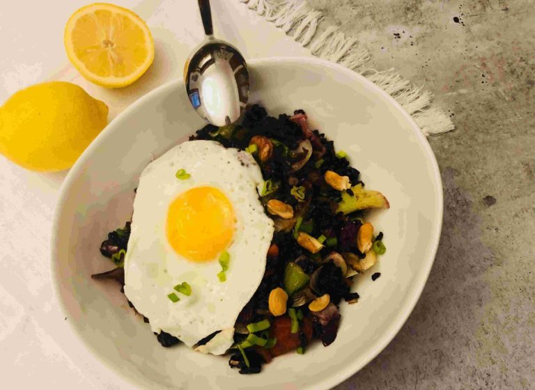 Thai stir-fry with bok choy, black rice and fried eggs by sun basket