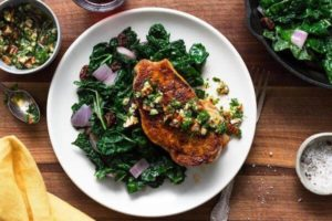 Languedoc-style pork with pecan aillade and braised kale